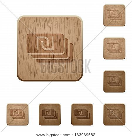 New Shekel banknotes on rounded square carved wooden button styles