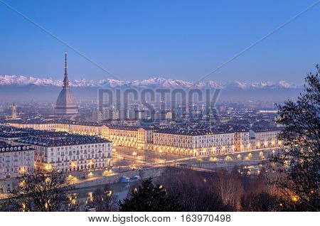 Turin panorama at blue hour with Mole Antonelliana Piazza Vittorio and the Alps in the background