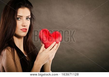 Beautiful Woman Holds Red Heart On Black