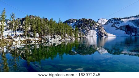 Crystal clear water in alpine lake. Inspiration lake. The Enchantments. Cascade Mountains. Seattle. Washington. USA.