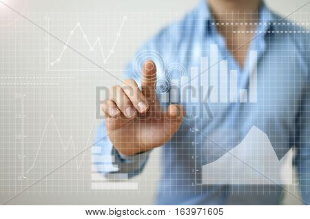 Business growth success concept with businessman and graphs