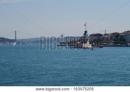 Famous Landmaker - Maiden's Tower - also known as Kizkulesi or Leandertower - in Istanbul, Turkey with Bosphorus Bridge