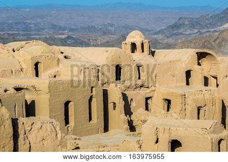 Houses of abandoned mud brick village of Kharanaq in Iran