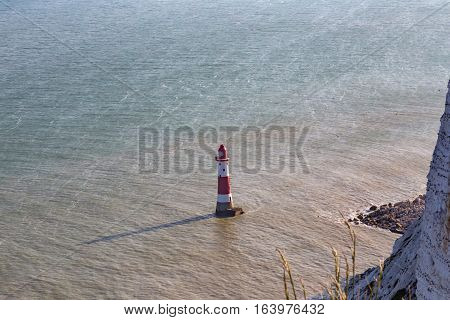 Lighthouse at Beachy Head, Sussex with a shadow.