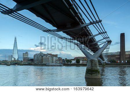 LONDON, ENGLAND - JUNE 17 2016: Twilight on the Thames river, Millennium Bridge and The Shard, London, Great Britain