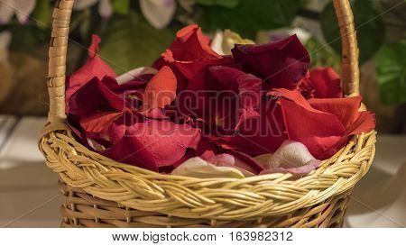Rose petals in a cute wicker basket