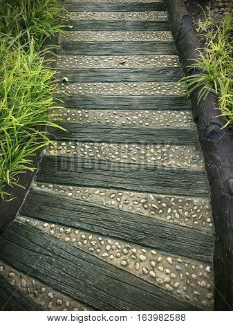 wood and stone pathway in the garden