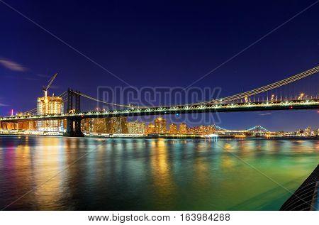 Panorama of Manhattan Bridge in New York City at night Manhattan Bridge and skyline At Night,