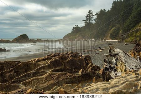 Rock-strewn Kalaloch Beach on Washington's Pacific Coast under a threatening sky