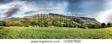 Stunning Welsh Mountains Under A Cloudy Blue Sky