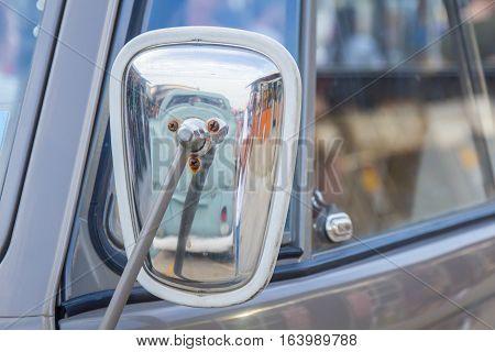 vintage or old car rear view mirror