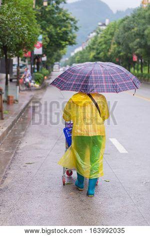 Woman With Umbrella Walking In The Falling Rain
