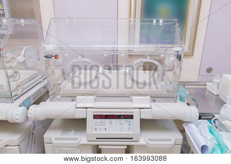 infant incubator in hospital post delivery room.