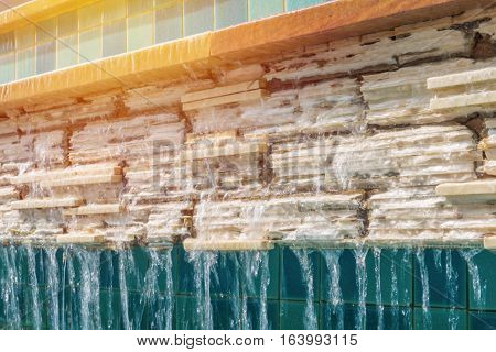 Water Fall On Brick With Tile Wall