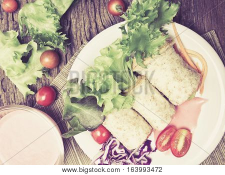 the fresh whole wheat bread wraps with vegetables and fruit on the plate healthy and clean food concept vintage color tone