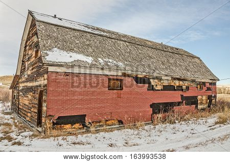 Built to look like a barn due to the agricultural area it is in this community hall has been patched in several places. It is the last remaining building in a small rural Montana town