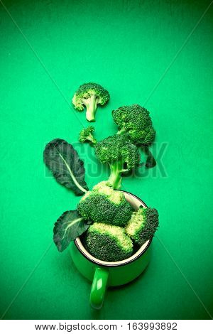 The Fresh Broccoli on green background nature green food concept