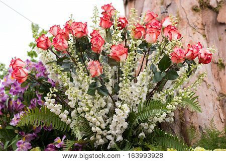 A beautiful flower arrangement with roses outdoors.