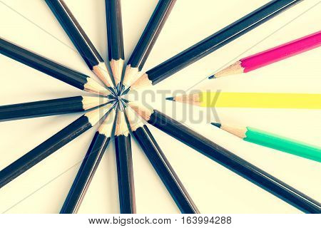 brown wooden pencil arrange as circular with one of different pencil try to close the gap on white background un matching and competition concept