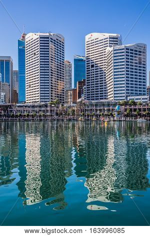 Sydney, NSW, Australia: April 27, 2016: High rise buildings seen across Darling Harbour with reflections in the water.