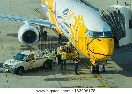 BANGKOK, THAILAND-DEC 29 2016. NOKAIR airline loading cargo on the plane at the gate in Don Mueang international airport (DMK)