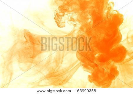 Abstract smoke Weipa. Personal vaporizers fragrant steam. The concept of alternative non-nicotine smoking. Orange vape smoke on a white background. E-cigarette. Evaporator. Taking Close-up. Vaping.