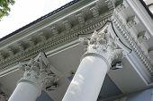 Capital gray closeup Corinthian columns on a building facade. poster