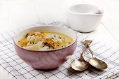 fish soup with smoked haddock potato and crushed peppercorn in a bowl poster