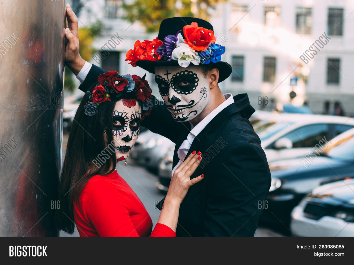 All Souls Day. Boy And Girl Sugar Skull Makeup.painted For Halloween  Standing On The Street. Dead In The City. Zombie Walk.day Of The Dead  Holiday In Mexico