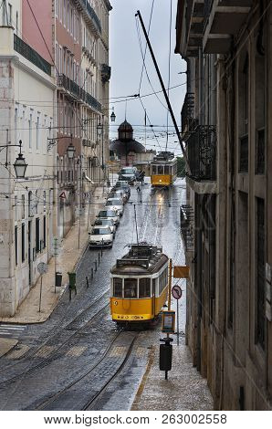 Lisbon, Portugal - February 16, 2010: Old Trams In A Street Of The Chiado Neighborhood In The City O