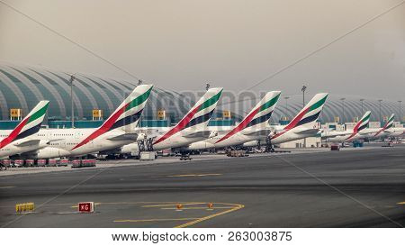 Emirate Planes Lined Up In A Row