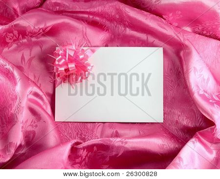 Blank Gift Card With Ribbon On Pink Satin