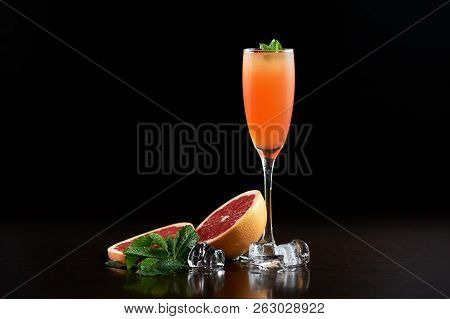 Tall Narrow Crystal Cocktail Glass With Cold Summer Refreshing Orange Juicy Drink, Slices Of Grapefr