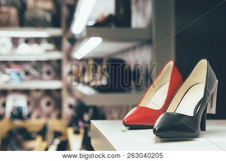 Red And Black Shoe On A Rack In A Shoe Shop. Black Friday, Sale, Consumerism Concept.