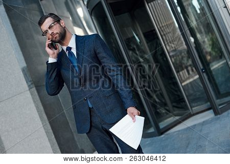 A Young Businessman With Glasses And A Beard Is Upset By A Failed Deal