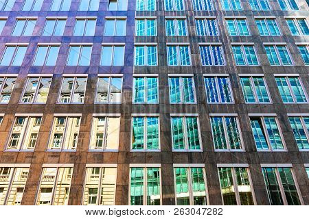Creative Abstract Architectural Style Contrast Background: Old House And Modern High Skyscraper Buil