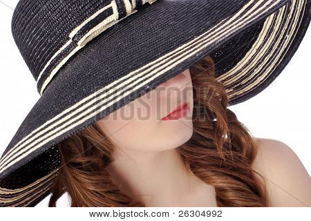 woman wearing a posh hat