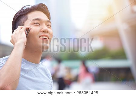 Young Smart Asian Male Teen Calling Phone Call Communication With Other
