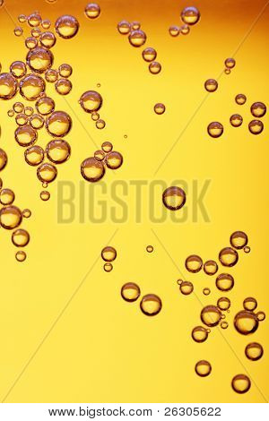 lots of bubbles floating in a drink