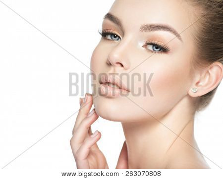 Beautiful face of a young white woman isolated on white background. Girl in beauty style.