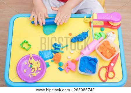 Top View Of Little Asian 2 Years Old Toddler Baby Boy Child Having Fun Playing Colorful Modeling Cla