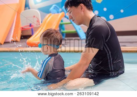 Cute Little Asian 2 Years Old Toddler Boy Child In Swimming Costume Learn To Swim At Indoor Salt Wat