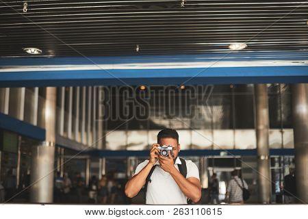 Pleasant Smiling Hindu Man Making Photos At The Station