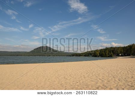 Machovo Jezero Lake With Sandy Beach And Borny Hill On Background In Czech Tourist Area Named Machuv