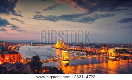 Budapest City Night Scene. View At Chain Bridge, River Danube And Famous Building Of Parliament. Bud