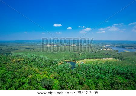 Landscape of a mountain hill at daytime. Landscape of a mountain hill at daytime. Mountain landscape in summer with cumulus clouds. Mountain meadow with fresh green grass. View at a mountain valley in summer poster
