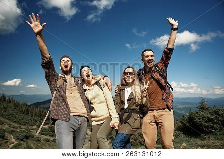 Laughing Friends Are Resting Actively In Mountains