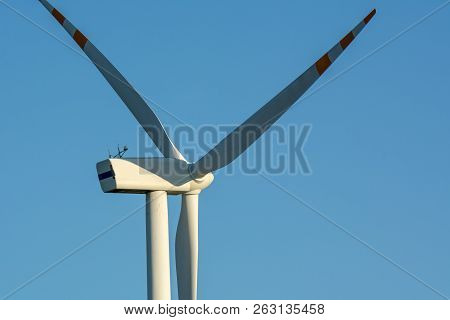 Wind Turbine Against Blue Sky. Wind Energy. Eco Concept.