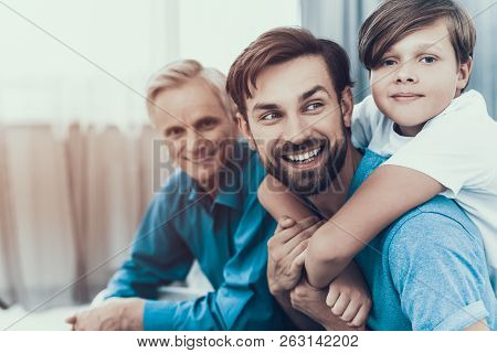 Happy Family Have Fun And Spends Time Together. Father And Son. Smiling People. Have Fun Indoor. Par