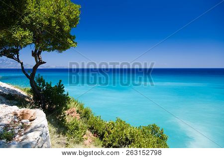 Wonderful And Beautiul Landscape About The Greek Turquoise Sea, And Harsh Green Vegetation.
